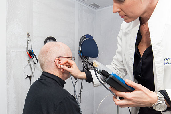 Patient with hearing loss taking a hearing test