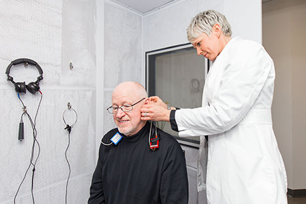 Patient getting a hearing test at Blue Sky Hearing