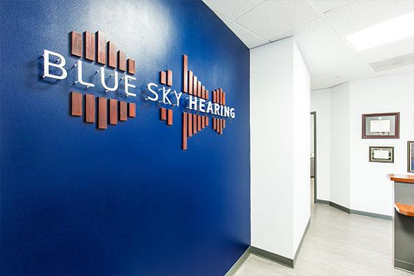 Blue Sky Hearing Logo on wall of office.