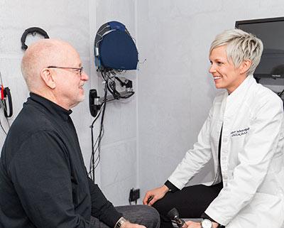 Susanna Storm, AU.D. discussing tinnitus management with a patient.